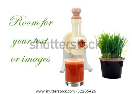 a juicer with carrot juice and wheat grass isolated on white with room for your text or images - stock photo