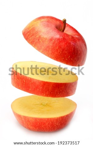 A juicy red apple is displayed in three individual sections. - stock photo
