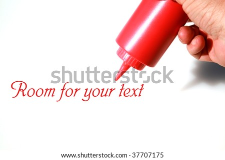 a ketchup squirt bottle in a persons hand on white - stock photo