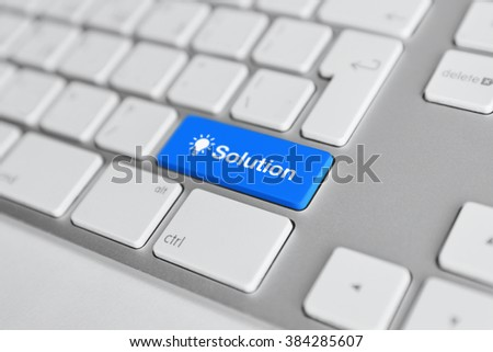 A keyboard with a blue button - solution - stock photo