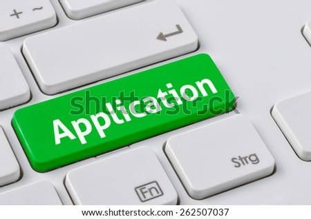 A keyboard with a green button - Application - stock photo