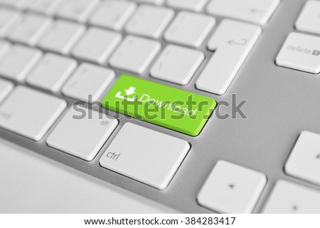 A keyboard with a green button - download - stock photo
