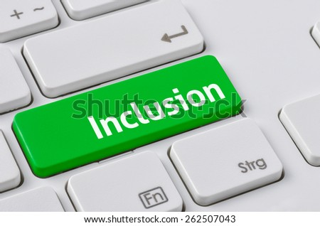 A keyboard with a green button - Inclusion - stock photo