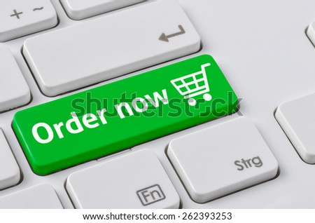 A keyboard with a green button - Order now - stock photo