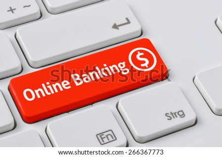 A keyboard with a red button - Online Banking - stock photo
