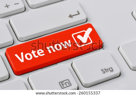 A keyboard with a red button - Vote now - stock photo