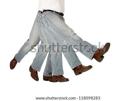 A kicking boot symbolizes being sacked or fired isolated on white - stock photo