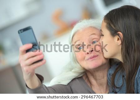 A kiss for grandma - stock photo