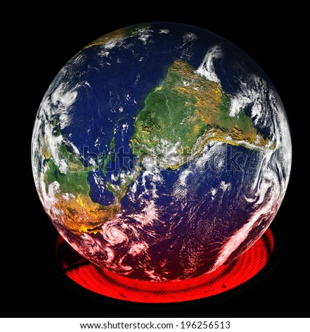 A kitchen burner heats up the earth turned on its side from the normal perspective. Elements of this image furnished by NASA - stock photo