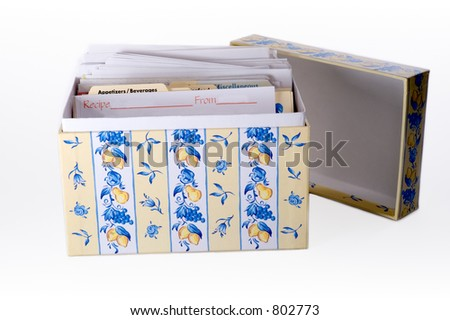 A kitchen recipe box filled with family recipes. - stock photo