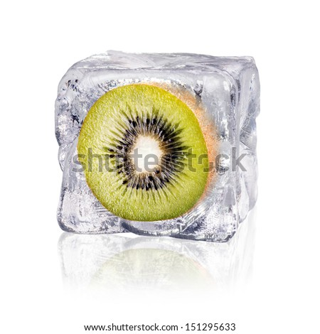 a kiwi enclosed in an ice cube before white background - stock photo