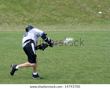 A lacrosse player taking a shot on goal. - stock photo