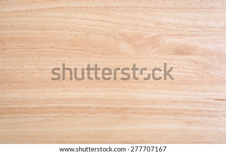 A laminated wood table top illuminated by natural light. - stock photo