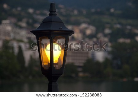 A Lamppost by Lake Geneva on a Summer Evening in Montreux, Switzerland - stock photo