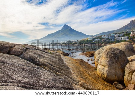 A Landscape image of a beautiful bay in Bakoven, Cape Town, South Africa with the peak of Lion's Head in the background - stock photo