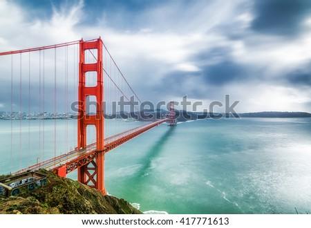 A landscape of Golden Gate Bridge, San Francisco, USA. Golden Gate Bridge is a landmark of San Francisco.  Golden Gate Bridge has 1-mile wide and 3-mile long. - stock photo