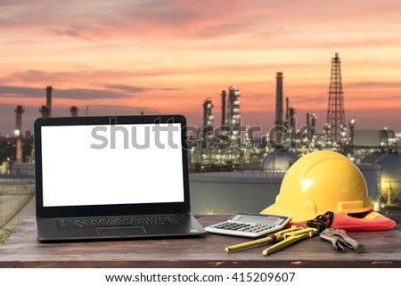 A laptop with the oil and gas industry background. - stock photo