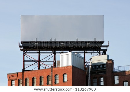 A large blank urban billboard with copy space ready for your design or mock up text. - stock photo