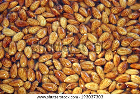 A large bowl of almonds at a street fair - stock photo