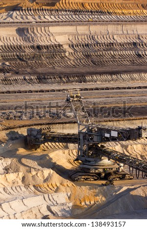 A large bucket wheel excavator digging brown-coal in an open-pit mine - stock photo