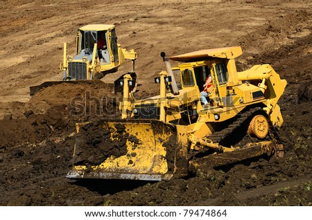 A large bulldozer grading a hillside in preparation for a major highway intersection project in Oregon - stock photo