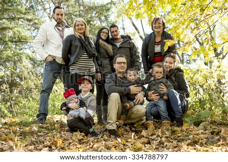 A large family with children in autumn park - stock photo