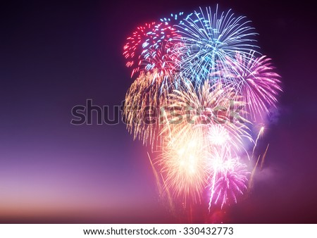 A large fireworks event with celebrations. - stock photo