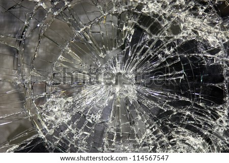 a large glass pane  broken in pieces - stock photo