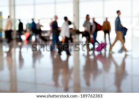 A large group of arriving passengers. Panorama. Motion blur. Airport. - stock photo