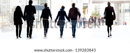 A large group of people on a light background. Panorama. Urban scene. - stock photo