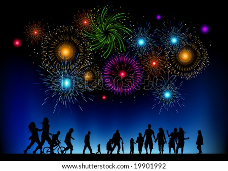 A large group of people watching a fireworks display. - stock photo