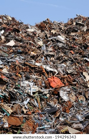 A large heap of metal and disposed items. - stock photo