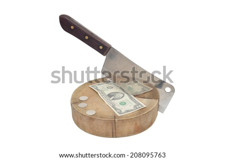 A large kitchen knife and cut bill on a cutting board  - stock photo