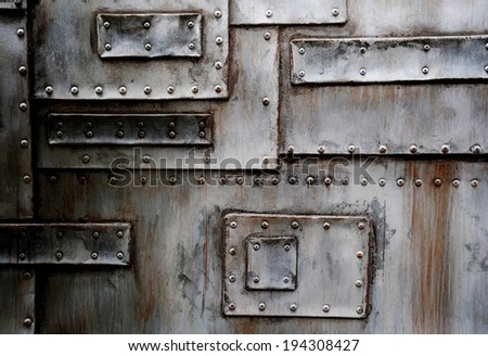 A large metal door with various rusted streaks. - stock photo
