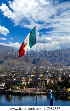 A large Mexican Flag flying at the Port of Ensenada - stock photo