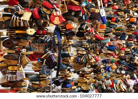 A large number of locks on the rails - stock photo