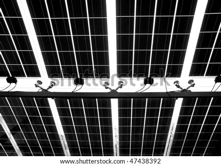 A large pattern of solar cells seen from underneath - stock photo