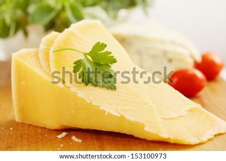 a large piece of  Swiss cheese and black olives - stock photo
