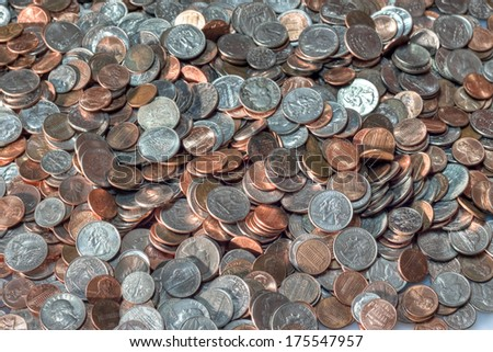 A large pile of american coins - stock photo