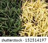 A large pile of green and wax beans at local farm market. - stock photo