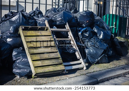 A large pile of rubbish bags on the street - stock photo