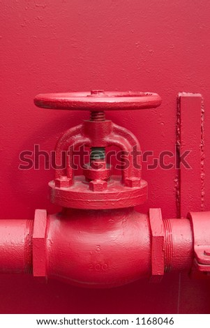 A large red valve - stock photo