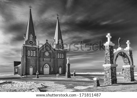 A large rural church along the seashore in rural Prince Edward Island.  Black and white with a slightly gritty look. - stock photo