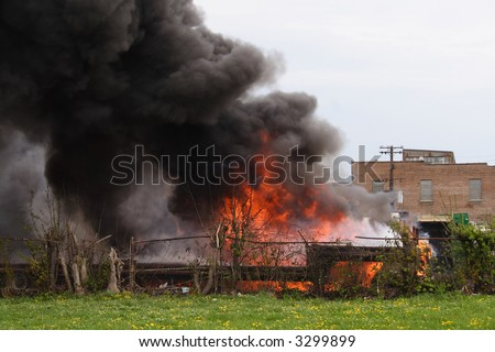 A large semi-truck explosion with flames and smoke - stock photo