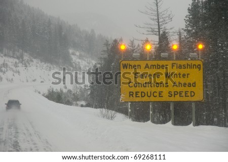A large sign indicating highway travel ahead is treacherous - stock photo