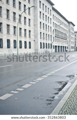 A large stone building next to a street in Berlin - stock photo