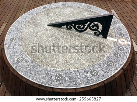 A large sundial timepiece that is aligned with the true north  - stock photo