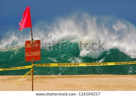A large Swell forces lifeguards to close the beach at Waimea Bay on Oahu, Hawaii. - stock photo