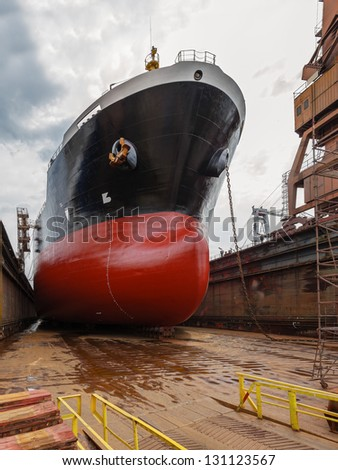 A large tanker ship is being renovated in shipyard Gdansk, Poland. - stock photo