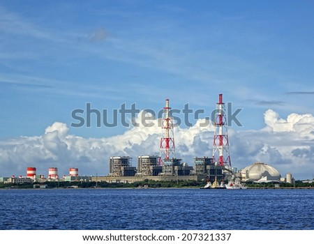 A large thermal power plant located close to the ocean  - stock photo